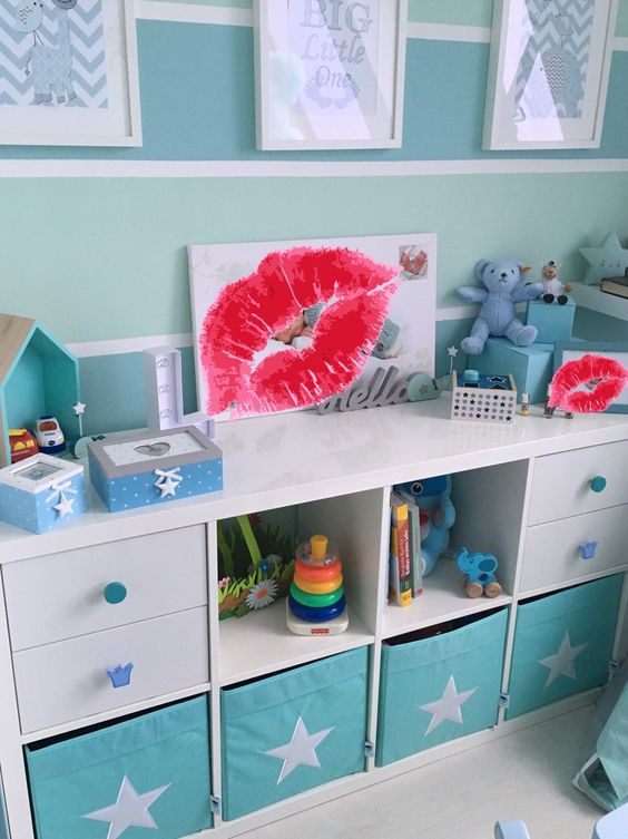 a Kallax shelf with turquoise Drona boxes with stars for a boy's room