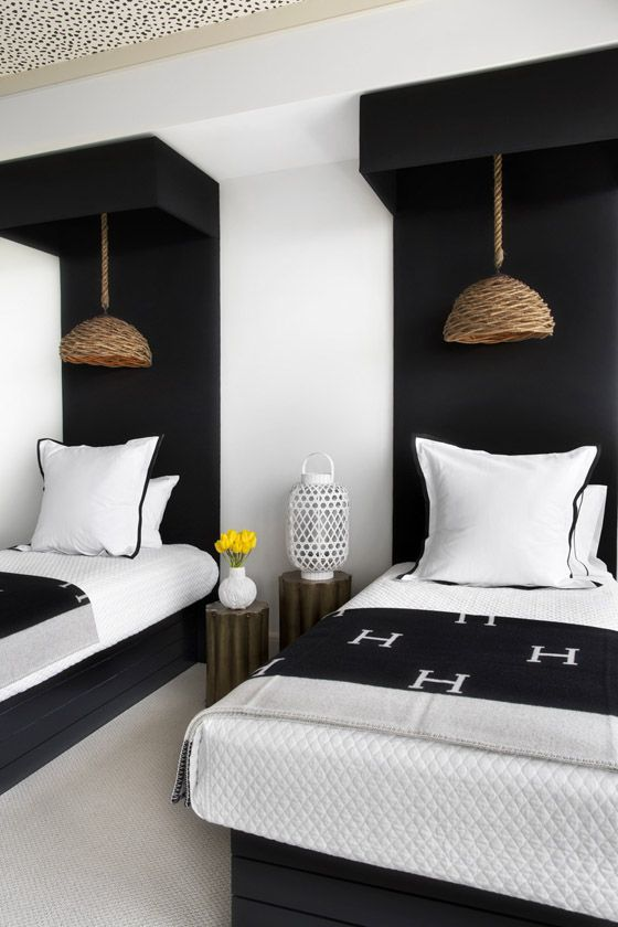 a cozy guest bedroom with a monochromatic color scheme and touches of wood and wicker