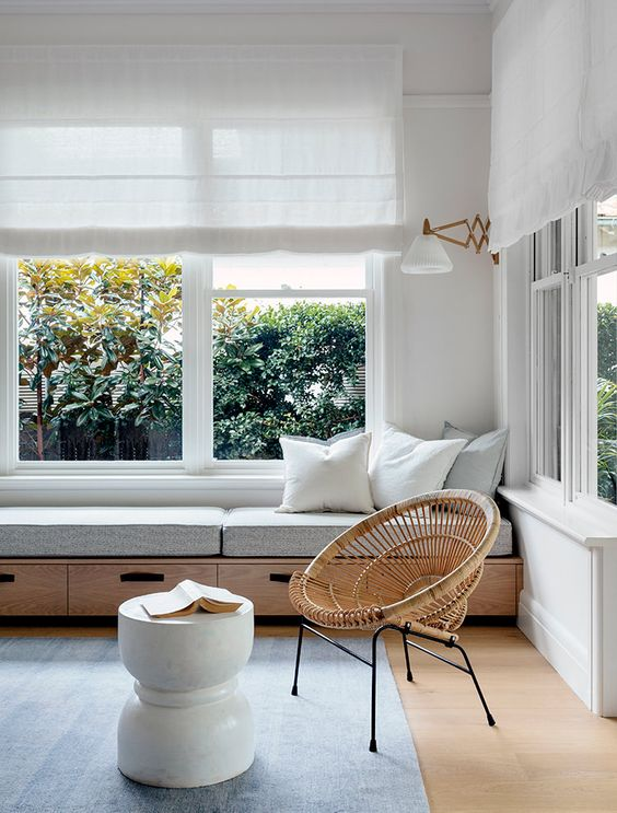 a minimalist windowsill bench with drawers under it will help to get rid of clutter