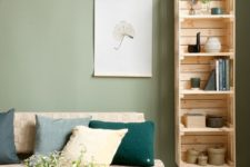 08 a modern bookshelf composed of IKEA Knagglig boxes and placed on legs is a cute and easy DIY