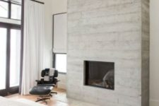 08 a neutral bedroom with touches of whitewahsed wood, with wooden floors and a leather chair plus various fabrics