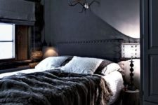08 a welcoming dark cabin bedroom with a wooden ceiling and a faux fur throw plus wooden touches