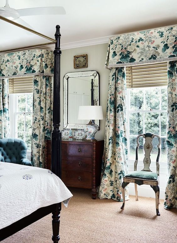 bold floral curtains add pattern to the bedroom, not only texture, they become a bold accent