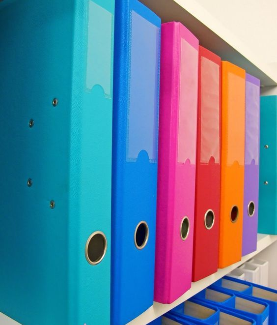 colorful binders can replace the old filing cabinet system making organizing papers much more comfortable