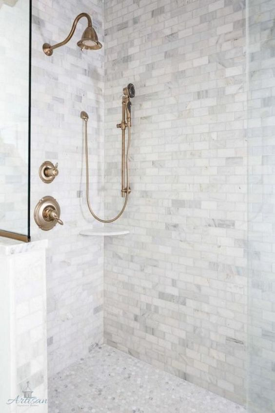 grey marble tiles   square ones on the walls and penny hex tiles on the floor create a chic and neutral combo for a bathroom