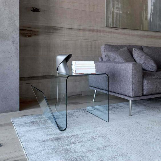 such a curved glass table will add a sophisticated yet modernized feel to the space