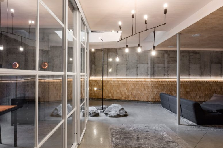Concrete, wood singles, real rocks and metal create an ambience that is outdoor and indoor