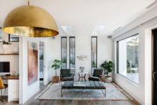 09 Some spaces feature mid-century modern furniture as inspiration from the origins of the house