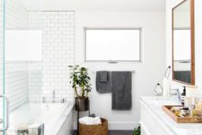 09 a neutral bathroom with white subway tiles and large grey tiles on the floor that stand out in these light shades