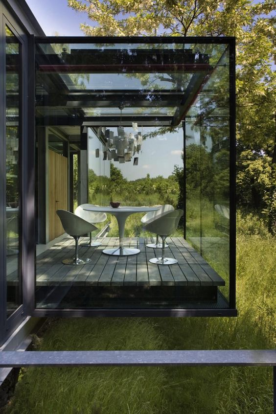 a smoked glass sunroom will keep more privacy and keep you away from the excessive sunlight