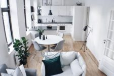 09 a tiny home with a dining, living space and a kitchen, all of them are united into a flowing space to fill it with light