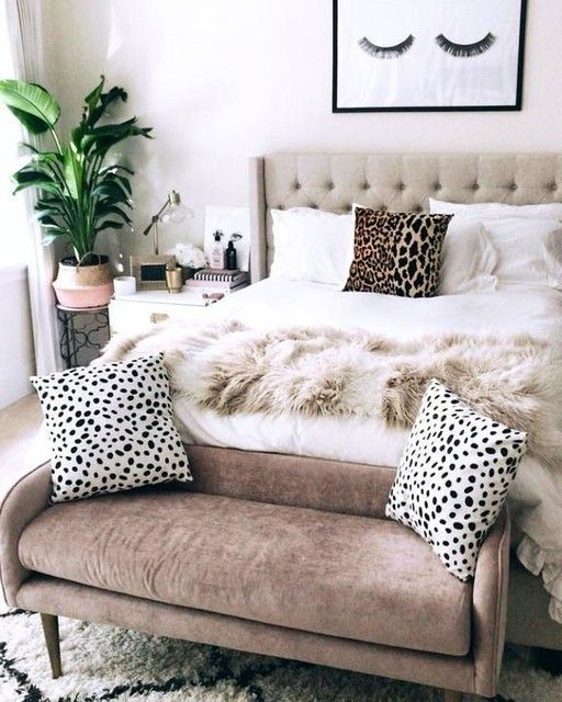 add texture and interest to the space placing such a chocolate velvet bench at the foot of the bed