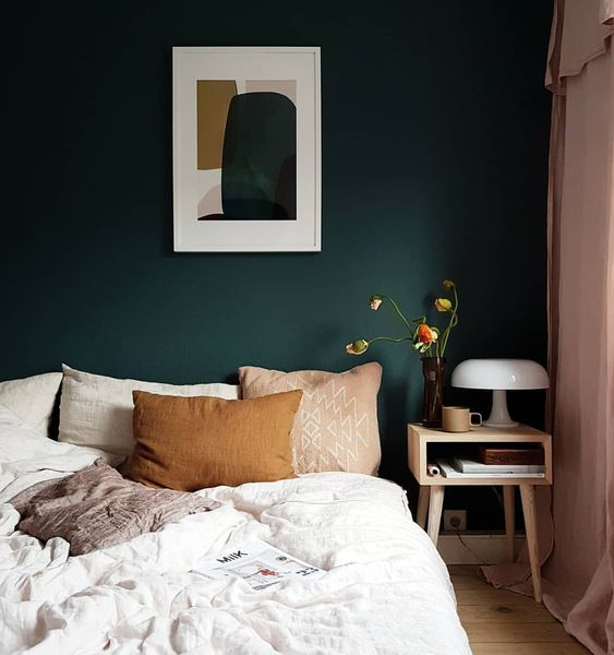 infuse your bedroom with a calming shade like dark green and you'll get a relaxed feel at once
