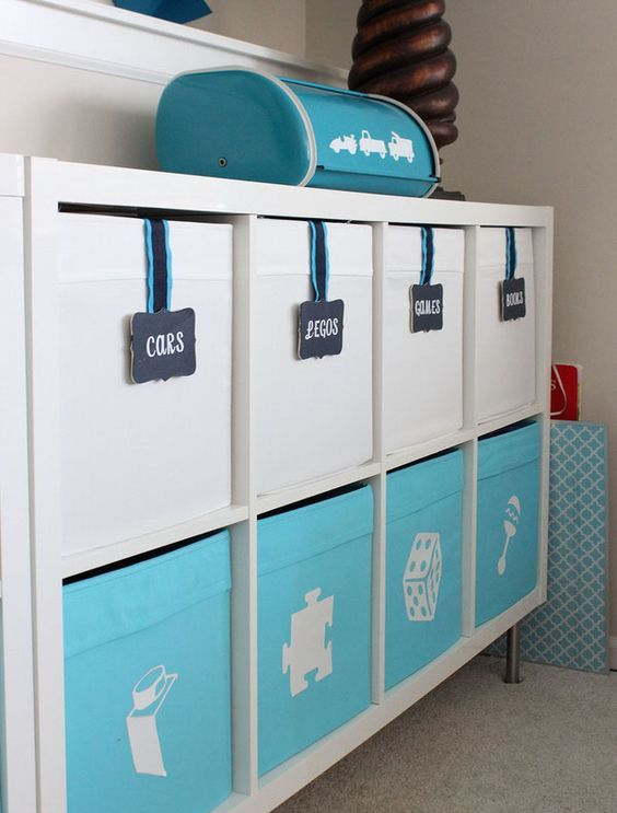a kid's furniture piece completed with IKEA Drona boxes, with labels and chalkboard markers