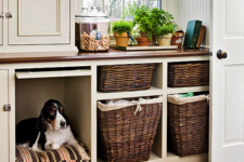 10 a laundry storage cabinet with a built-in dog bed so that your dog could keep your company while you are doing things