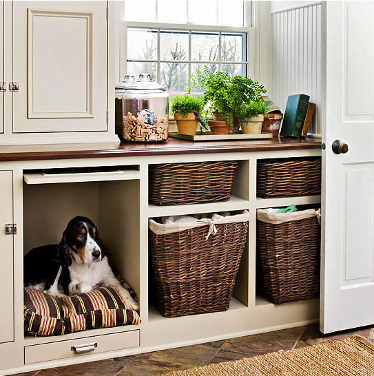 a laundry storage cabinet with a built in dog bed so that your dog could keep your company while you are doing things