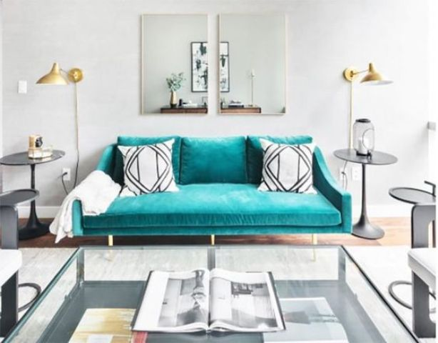 a turquoise suede sofa makes a colorful statement and a bold accent in the living room