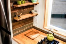 10 tiny floating shelves over the cabinets are amazing for storage and don't look bulky at all