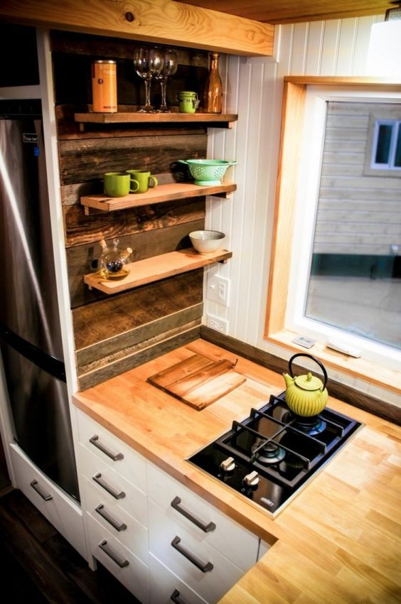 tiny floating shelves over the cabinets are amazing for storage and don't look bulky at all