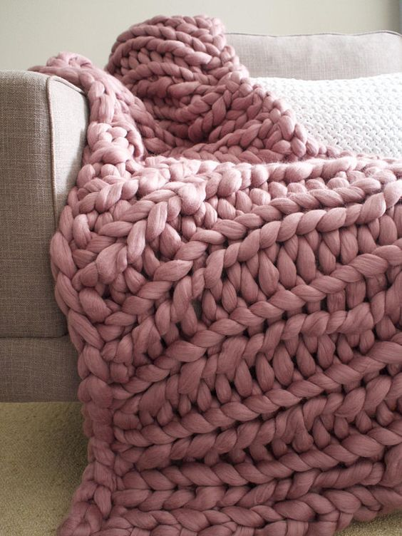 a chunky knit blanket in dusty pink is a very cozy idea for winter, which is on now
