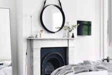 11 a fireplace as a centerpiece of the bedroom, done with wrought details and a chic stone mantel