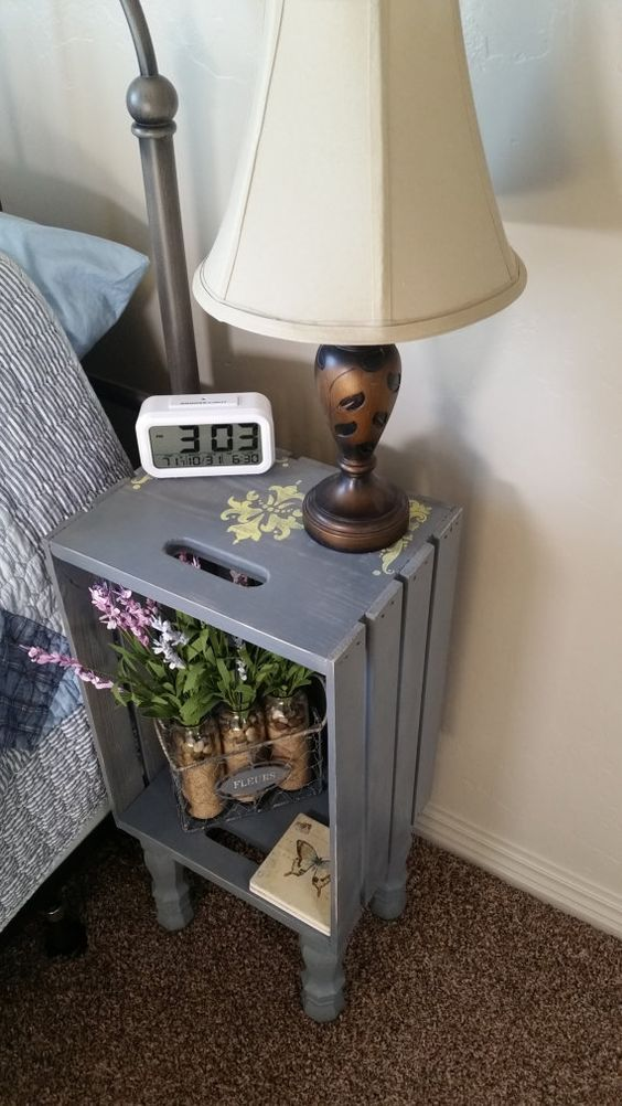 a grey bedside table of a Knagglig box placed on legs is a very vintage-like option
