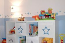 11 a kid's sideboard with Drona boxes marked with pretty stars is a cute idea