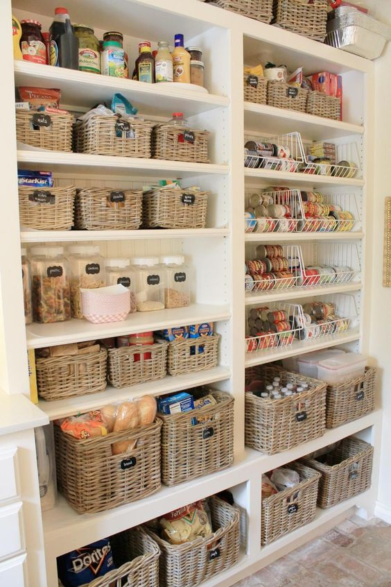 a perfectly organized pantry with baskets and jars and chalkboard labels for a stylish look