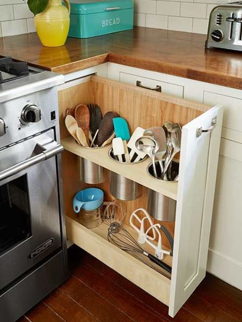 a pull out storage drawer that uses the dead space by the cooker and stores various cutlery