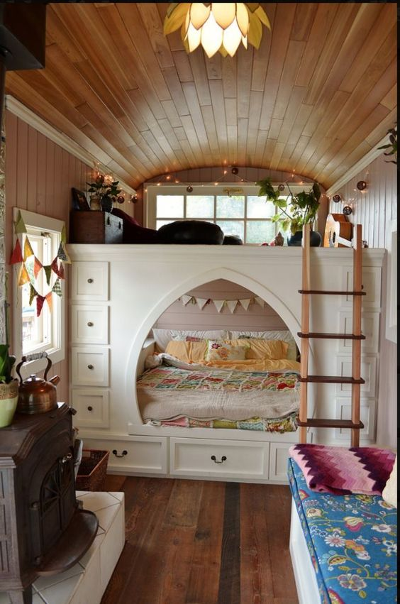 a smart built in bed with additional storage drawers on each side is a cool way to go