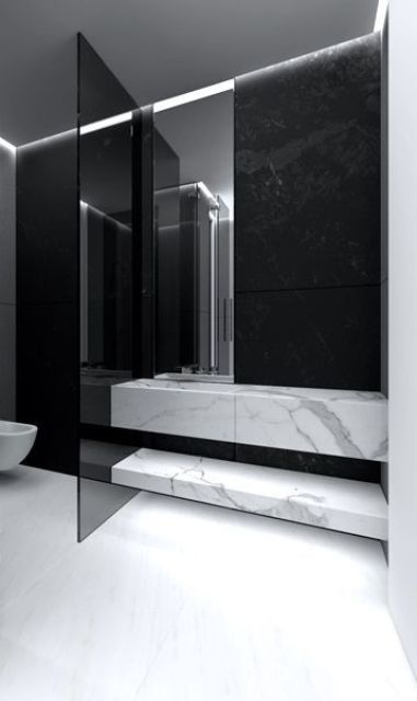a smoked glass toilet door divides the zones in your bathroom gently, subtly, yet stylishly and edgy
