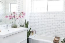 11 black hex penny tiles and white subway tiles create a bold look, and wood adds warmth and intrest to the space