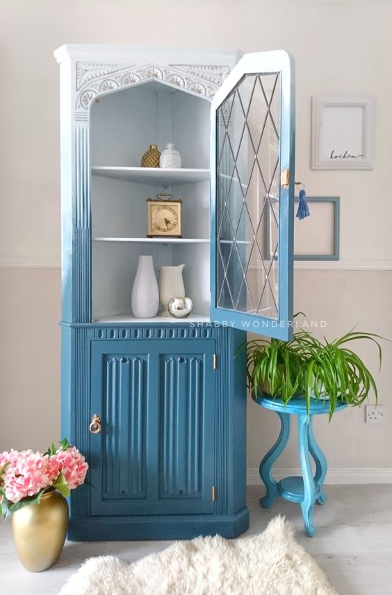 grab a vintage corner cabinet and give it an ombre look for a modern and bright feel