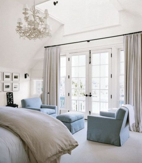 a chic nook of two powder blue chairs and an ottoman make a relaxing nook and add color to the space