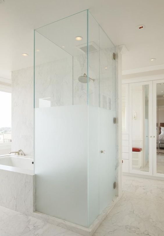 a half frosted glass shower next to the bathtub is a gorgeous contemporary bathroom decor idea