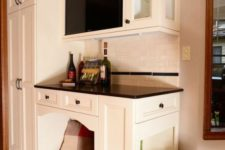 12 a home bar with an integrated dog bed and even dog feeding station on the side
