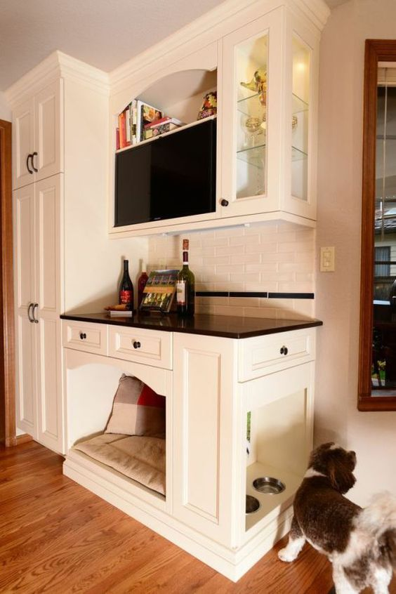 a home bar with an integrated dog bed and even dog feeding station on the side