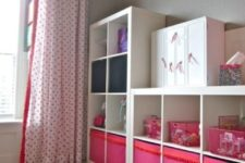 12 a kids' storage unit made of Expedit and of colorful Drona boxes with a pompom trim
