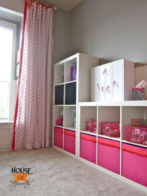 a kids' storage unit made of Expedit and of colorful Drona boxes with a pompom trim