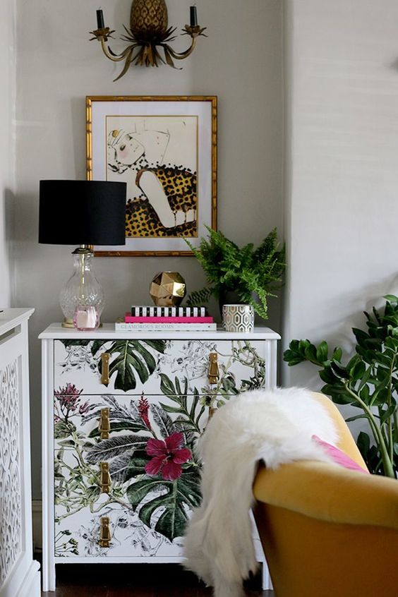 a sideboard upcycled with bright botanical and floral prints and leather pulls looks stunning