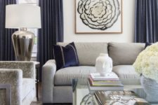 12 a stylish living room with grey furniture and navy pillows and curtains create a very chic and refined look