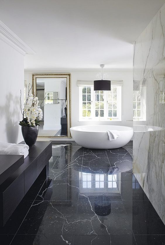 black marble tiles on the floor bring luxury and chic, and white marble tiles on the walls just add to it