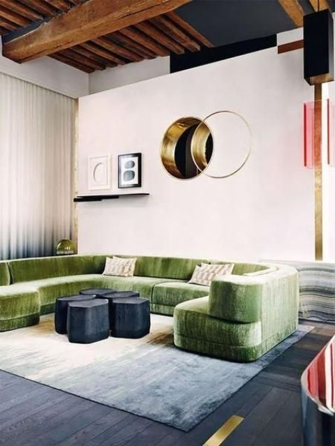 this green sofa makes a statement not only with texture but also with its color and unique shape