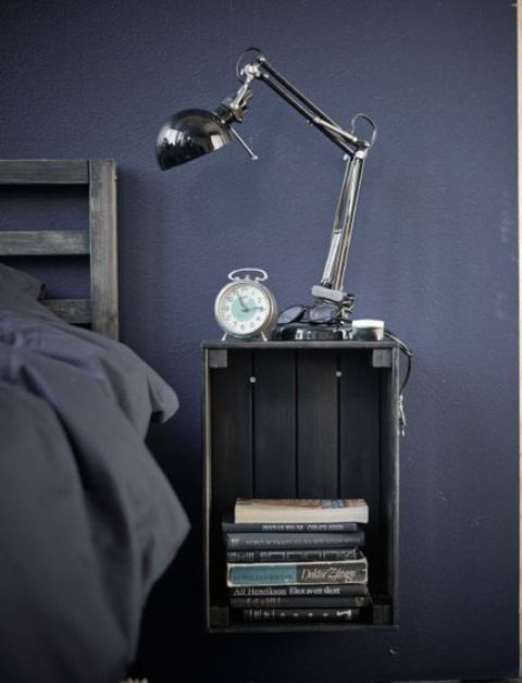 a Knagglig box painted grey and attached to the wall makes up a cool floating bedside table and saves floor space
