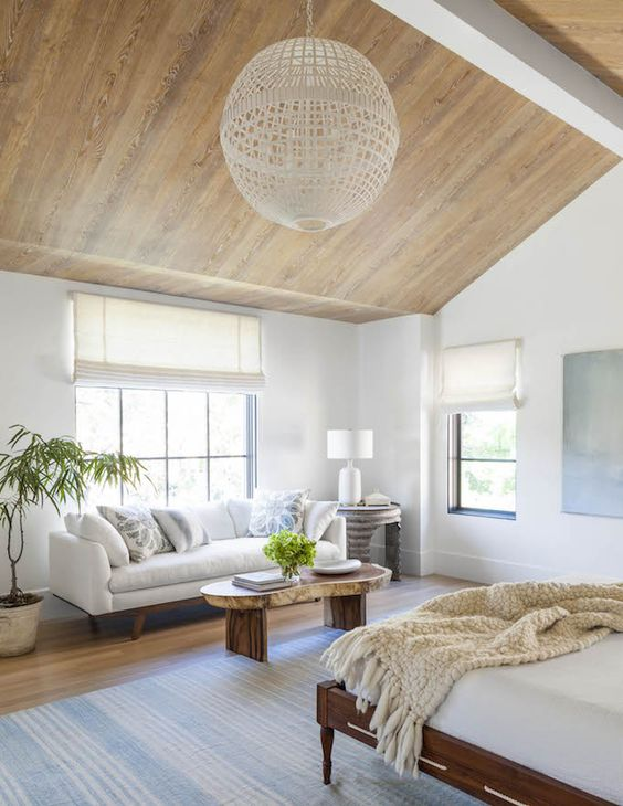 a comfy sofa by the window and a coffee table is a cool relaxing space to rock