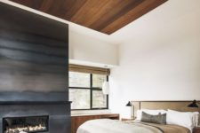 13 a fireplace completely covered with darkened metal is a gorgeous statement for a neutral bedroom
