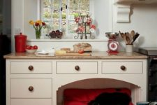 13 a kitchen cabinet with a bright and soft dog bed included to prevent your pet from disturbing you while cooking
