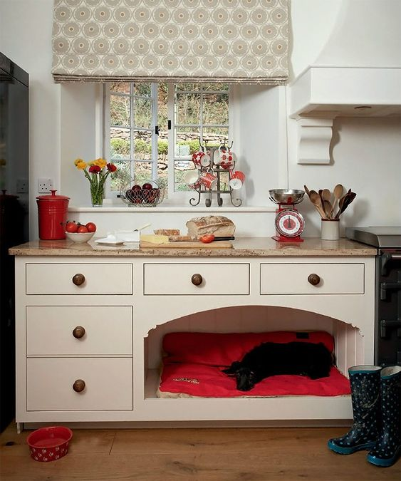 a kitchen cabinet with a bright and soft dog bed included to prevent your pet from disturbing you while cooking