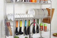 13 a stylish and comfy shelving unit over the sink with plates, mugs, pots and spoons is a smart idea