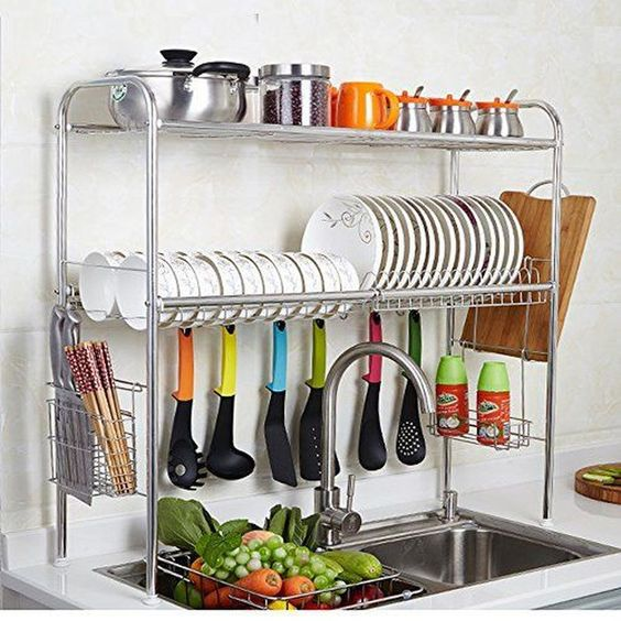 a stylish and comfy shelving unit over the sink with plates, mugs, pots and spoons is a smart idea